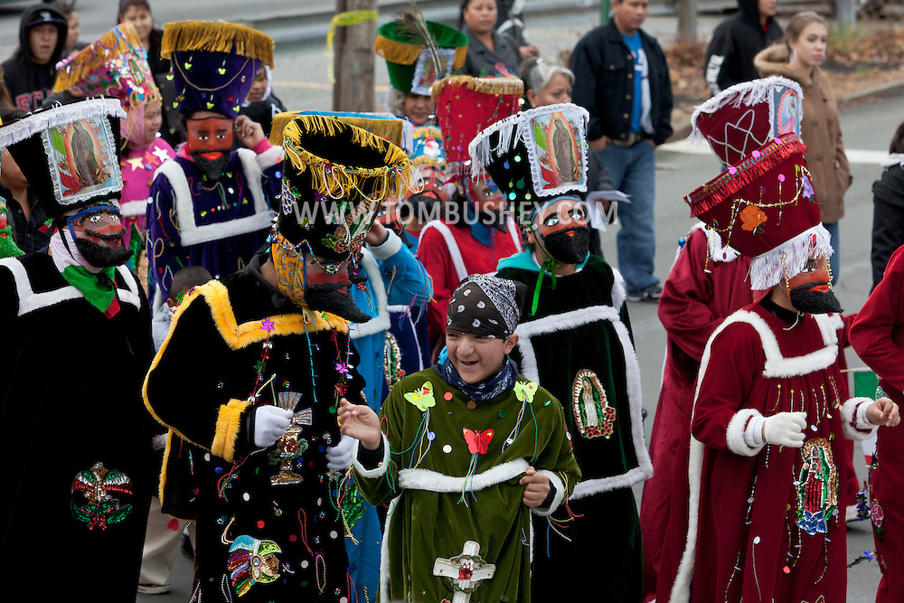 Middletown, New York - Members of St. Joseph's Church wearing traditional costumes march through the city during the festival of Nuestra Senora de Guadalupe on Sunday, Dec. 9, 2012.