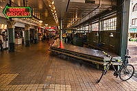 The main entrance to Pike Place Market is empty. My bicycle, once again, is featured to add foreground interest. Pike Place Market is one of Seattle's main attractions that's usually teeming with curious visitors and friendly merchants selling fresh produce, souvenirs, clothing, and trinkets. (March 21, 2020).