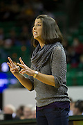 WACO, TX - DECEMBER 12:  Head coach Misti Cussen of the Oral Roberts University Golden Eagles calls in a play to her team against the Baylor University Bears on November 13, 2012 at the Ferrell Center in Waco, Texas.  (Photo by Cooper Neill/Getty Images) *** Local Caption *** Misti Cussen