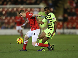 Barnsley's Peter Ramage and Yeovil Town's Joel Grant battle for the ball - Photo mandatory by-line: Matt Bunn/JMP - Tel: Mobile: 07966 386802 14/12/2013 - SPORT - Football - Barnsley - Oakwell - Barnsley v Yeovil Town - Sky Bet Championship