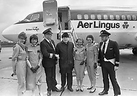 Cabin crew with Monsignor James Horan at Knock Airport for the first commercial Aer Lingus flights which took off on a pilgrimage to Rome. 1985. (Part of the Independent Newspapers Ireland/NLI Collection)