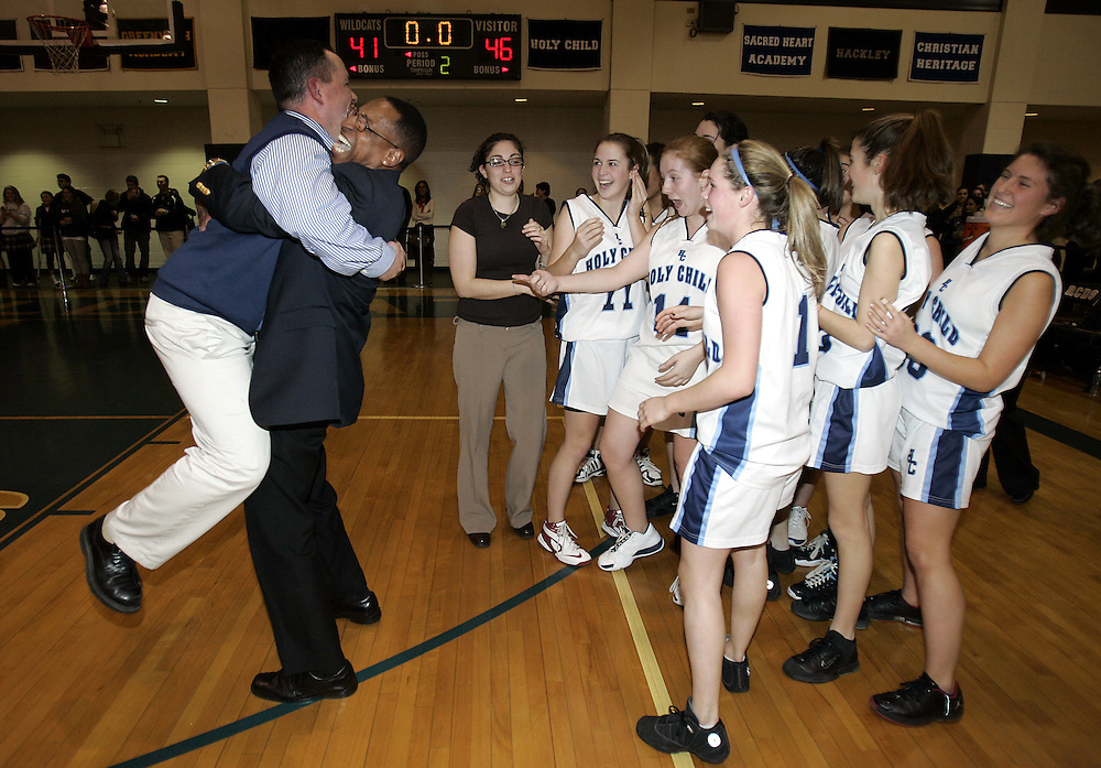 Holy Child head coach Mike Duignan, left, gets a big hug on the court at the end of the FAA Girls Basketball Championship betweem Holy Child and Rye Country Day at Rye Country Day School Feb. 27, 2009. Holy Child won the game 46-41.  ( Mike Roy / The Journal News )