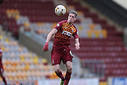 Bradford City defender, on loan from West Ham United, Reece Burke (16)  heads the ball back during the Sky Bet League 1 match between Bradford City and Millwall at the Coral Windows Stadium, Bradford, England on 26 March 2016. Photo by Simon Davies.