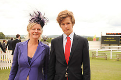 The COUNTESS OF MARCH and her son LORD SETTRINGTON at the third day of the 2010 Glorious Goodwood racing festival at Goodwood Racecourse, Chichester, West Sussex on 29th July 2010.