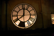 blurry view of a large clock in a wall
