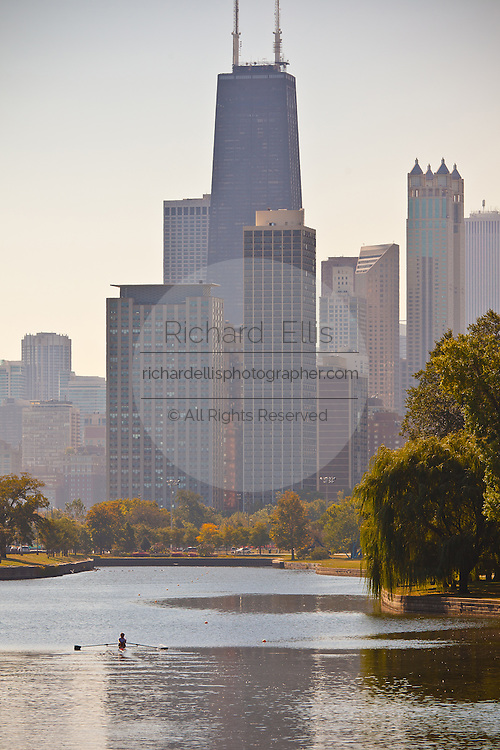 A rowing shell in Lincoln Park with the Chicago skyline.