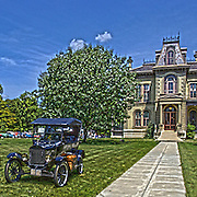 An antique vintage Ford sits on the lawn of the David Davis Mansion in Bloomington Illinois.<br /> <br /> This image was produced in part utilizing High Dynamic Range (HDR) or panoramic stitching or other computer software manipulation processes. It should not be used editorially without being listed as an illustration or with a disclaimer. It may or may not be an accurate representation of the scene as originally photographed and the finished image is the creation of the photographer.