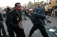 Violent clashes between pro and anti Mubarak in Tahrir Square..Anti Mubarak demonstrators throw rocks at Egyptian president supporters..