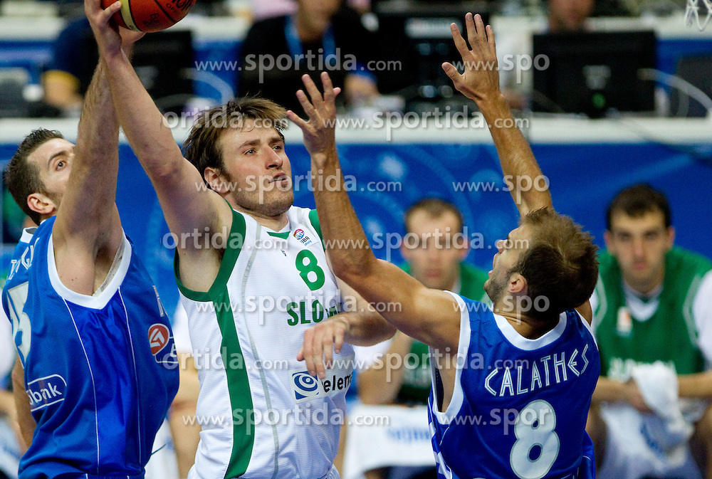 Matjaz Smodis of Slovenia between Ioannis Bourousis of Greece and Nick Calathes of Greece during basketball game between National basketball teams of Slovenia and Greece at FIBA Europe Eurobasket Lithuania 2011, on September 8, 2011, in Siemens Arena,  Vilnius, Lithuania. (Photo by Vid Ponikvar / Sportida)