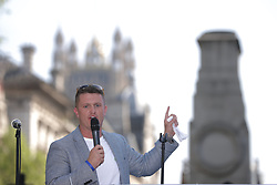 "© Licensed to London News Pictures . 06/05/2018. London, UK. TOMMY ROBINSON speaks at the demo. Supporters of alt-right and anti-Islam groups, including Generation Identity and the Democratic Football Lads Alliance, demonstrate at Whitehall in Westminster, opposed by anti-fascists. Speakers billed in the ""Day for Freedom"" include former EDL leader Tommy Robinson, Milo Yiannopoulos, youtuber Count Dankula (Markus Meechan), For Britain leader Anne Marie Waters, UKIP leader Gerard Batten, Breitbart's Raheem Kassam and Lauren Southern. The event was originally planned as a march to Twitter's HQ in protest at their banning of Robinson and the Home Office's ban on Martin Sellner and Brittany Pettibone entering the UK, in what protesters describe as limits being imposed on free speech. Photo credit: Joel Goodman/LNP"