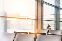 Photo of empty chairs on airport gate with lens flare