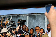 Matt Roth/Novus Select.Thursday, March 22, 2012..Members of the press photograph Rev. Al Sharpton, while he announces that the Sanford Chief of Police Bill Lee has temporarily stepped down before the official start of a rally addressing Trayvon Martin's killing at Fort Mellon Park in Sanford, Florida Thursday, March 22, 2012. Standing on the stage with Rev. Al Sharpton is the Martin's attorney Benjamin Crump, far left, Sybrina Fulton, the mother of Trayvon Martin, directly left of Sharpton, and Tracy Martin, far right, the father of Trayvon Martin...Rev. Al Sharpton spoke at the rally for the slain black teen who was unarmed and shot after an altercation by neighborhood watch volunteer George Zimmerman, who pursued Trayvon on foot after being told not to by 911 dispatchers. Zimmerman has yet to be arrested because of Florida's Stand Your Ground Law.