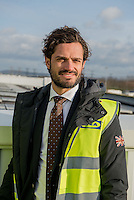 LYON, FRANCE - JANUARY 27: Prince Carl Philip of Sweden, accompanied with the ambassadress of Sweden Veronika Wand-Danielsson, have visited the central warehouse of Ikea to Saint-Quentin-Fallavier and prince showed himself very interested in the installations of solar energy, to the avant-garde regarding sustainable development on January 27, 2015 in Lyon, France. (Photo by Bruno Vigneron/Getty Images)