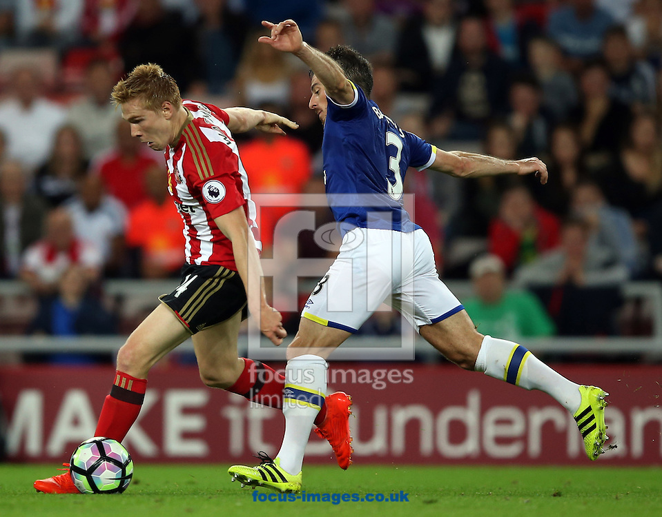 Duncan Watmore of Sunderland and Leighton Baines of Everton during the Premier League match at the Stadium Of Light, Sunderland<br /> Picture by Christopher Booth/Focus Images Ltd 07711958291<br /> 12/09/2016