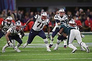 Philadelphia Eagles defensive end Brandon Graham (55) is blocked by New England Patriots offensive guard Shaq Mason (69) and New England Patriots offensive tackle Cameron Fleming (71) as he rushes on a key fourth quarter play resulting in a strip sack and fumble that turns the ball over to the Eagles during the 2018 NFL Super Bowl LII football game against the New England Patriots on Sunday, Feb. 4, 2018 in Minneapolis. The Eagles won the game 41-33. (©Paul Anthony Spinelli)