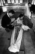 A passed away patient is  about to be cremated at the Aids hospice at the Wat Phrabath Namphu. November 2002..At the Wat Phrabath Namphu temple in Lopburi, 150 km. North of Bangkok, a hospice for dying Aids patients is based. Founded in 1992 by a Buddhist monk, already over 7500 people have died in this terrible but peaceful place. Mostly young people discarded by their loved ones out of fear for a terrible disease. At this spot many people have found a restful place to face their destiny in a state of medical abandonment. In most hospitals in Thailand, HIV infected people were and occasionally still are rejected and medical treatment is refused.