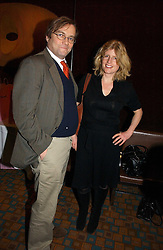 Writer RACHEL JOHNSON and her husband  at the launch of  'Idiot-Proof Diet' by Neris Thomas and India Knight held at The Arts Club, 40 Dover Street, London on 11th January 2007.<br />