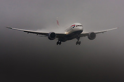 "January 3rd 2015, Heathrow Airport, London. Low cloud and rain provide ideal conditions to observe wake vortexes and ""fluffing"" as moisture condenses over the wings of landing aircraft. With the runway visible only at the last minute, several planes had to perform a ""go-round"", abandoning their first attempts to land. PICTURED: Water vapour ""fluffs"" over the surface of a landing British Airways Boeing 787 Dreamliner at London Heathrow."
