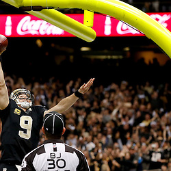 Dec 29, 2013; New Orleans, LA, USA; New Orleans Saints quarterback Drew Brees (9) celebrates by dunking over the goal post after running in for a touchdown during the fourth quarter of a game against the Tampa Bay Buccaneers at the Mercedes-Benz Superdome.The Saints defeated the Buccaneers 42-17. Mandatory Credit: Derick E. Hingle-USA TODAY Sports