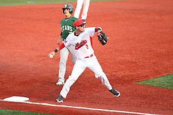 21 April 2015:  Ryan Koziol taps third for a force out and steps to throw to first in an attempt to get a double play during an NCAA Inter-Division Baseball game between the Illinois Wesleyan Titans and the Illinois State Redbirds in Duffy Bass Field, Normal IL