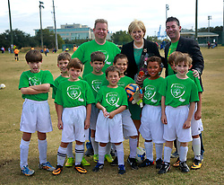 08 November 2014. New Orleans, Louisiana. <br /> Heather Humphreys, Irish Fine Gael politician and the Minister for Arts, Heritage and the Gaeltacht pays a visit to Carrolton Boosters Soccer Club. Humphreys was met by players from the U10 Team Ireland with coach Adrian D'Arcy (l) and assistant coach Michael Hecht (rt).<br /> Photo; Charlie Varley/varleypix.com