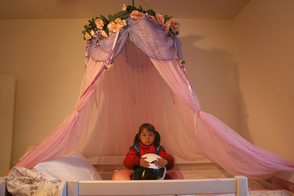 Chloe St. George, 6 years-old, poses in her bedroom in her family's home in Las Vegas, NV on Sunday, March 4, 2007. Chloe, who began racing six months ago, is one of a few female competitors in this sport.  ....