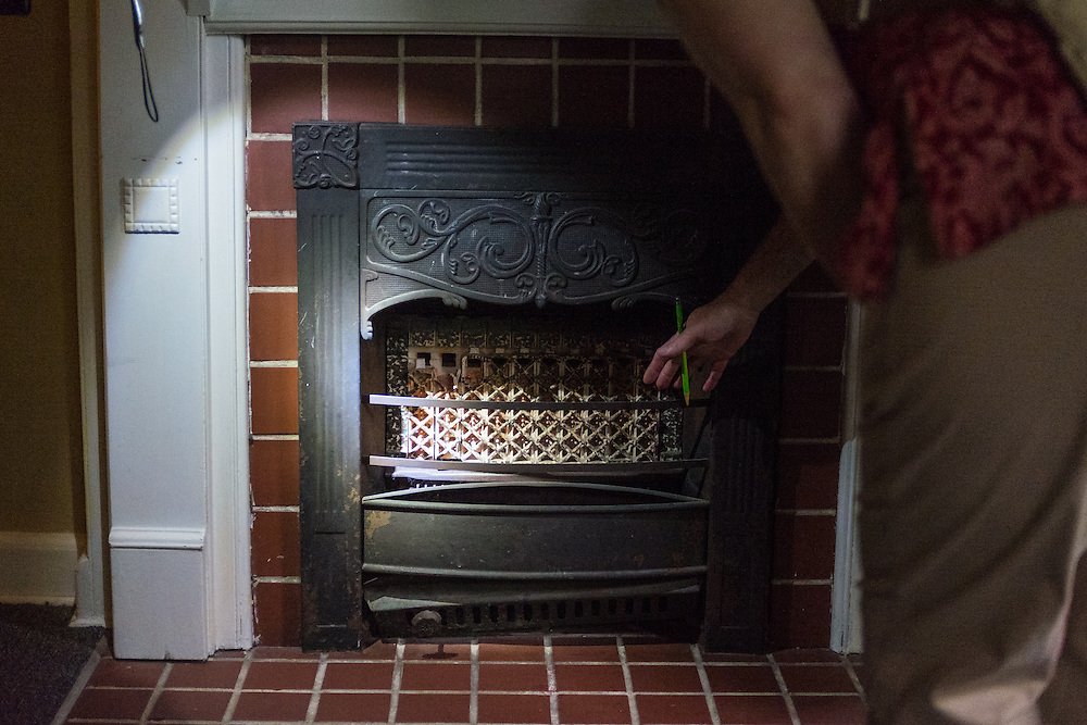 An energy audit of 47 West Washington Street included a discussion of possilbe air leaks such as those that can found in fireplaces.  Photo by Ohio University  /  Rob Hardin