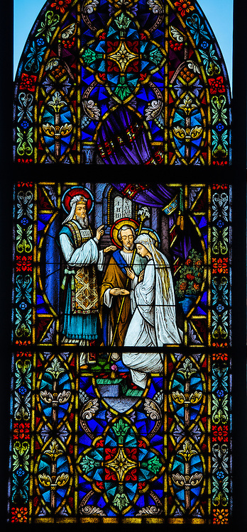 Stained glass window at Holy Family Church in Brillion, Wis. Betrothal of the Virgin Mary and Joseph. (Sam Lucero photo)