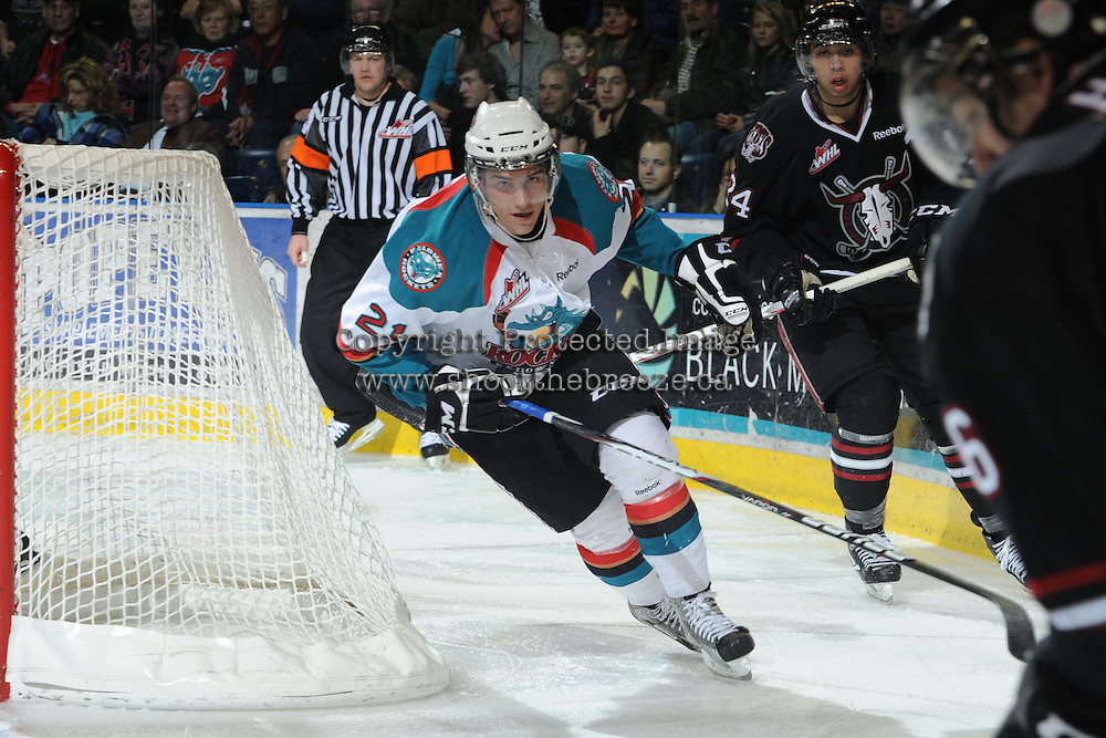 KELOWNA, CANADA - FEBRUARY 18: Brett Lyon #21 of the Kelowna Rockets skates behind the net against the Red Deer Rebels at the Kelowna Rockets on February 18, 2012 at Prospera Place in Kelowna, British Columbia, Canada (Photo by Marissa Baecker/Shoot the Breeze) *** Local Caption ***