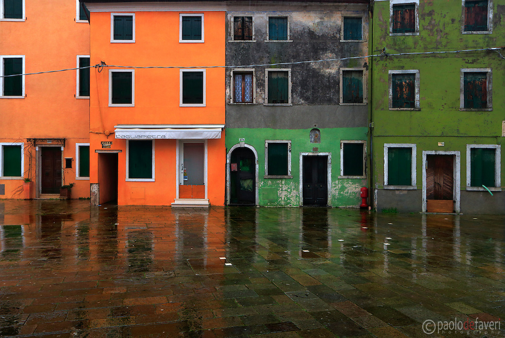 The crazy colors of the houses of Burano, a small island in the Venetian Lagoon, Italy, in a rainy day of February