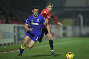 Wimbledon's Seth Owens and Brighton's Will Collar during the EFL Trophy match between AFC Wimbledon and U23 Brighton and Hove Albion at the Cherry Red Records Stadium, Kingston, England on 6 December 2016.