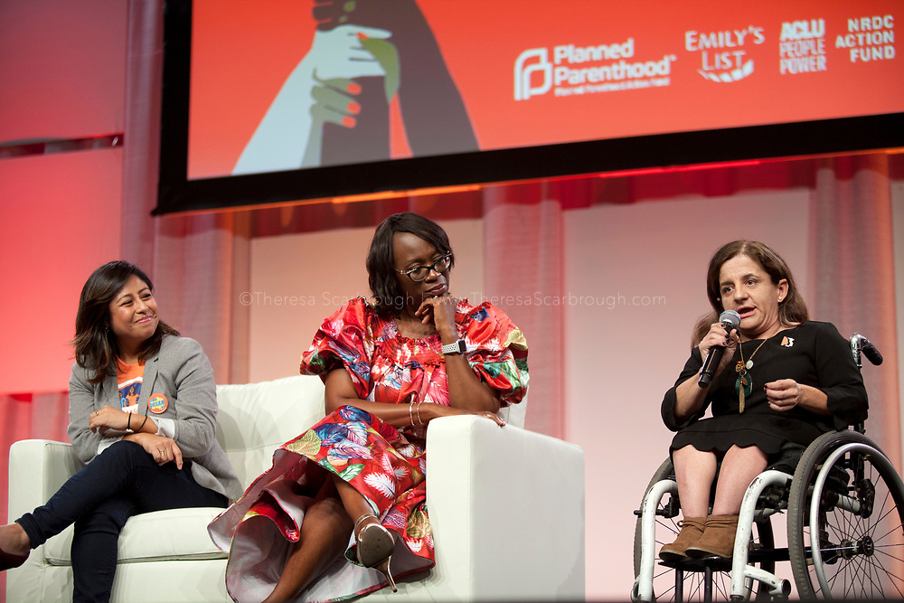 Detroit, Michigan, USA. 27th Oct, 2017. Colleen Flanagan (right), Co-Founder & Excutive Director for Disability Action for America, speaks as (L-R) Cristina Jimenez and Senator Nina Turner look on, during the Women's Convention held at the Cobo Center, Detroit Michigan, Friday, October 27, 2017