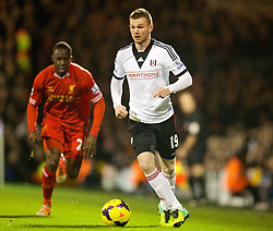 LONDON, ENGLAND - Wednesday, February 12, 2014: Fulham's Ryan Tunnicliffe in action against Liverpool during the Premiership match at Craven Cottage. (Pic by David Rawcliffe/Propaganda)