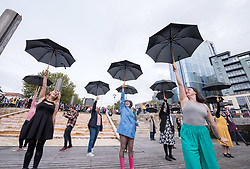 © Licensed to London News Pictures. 12/10/2019. Bristol, UK. A flash mob in Bristol city centre does the dance routine from the classic film musical Singin' in the Rain (1952) in the first event in three major UK cities in the coming weeks, organised by the BFI Film Audience Network. The events are to herald a season of film musicals including re-releases of classic musicals at cinemas and venues across the UK such as Singin' in the Rain (1952), led by BFI, the Independent Cinema Office and Film Hub Midlands. Photo credit: Simon Chapman/LNP.