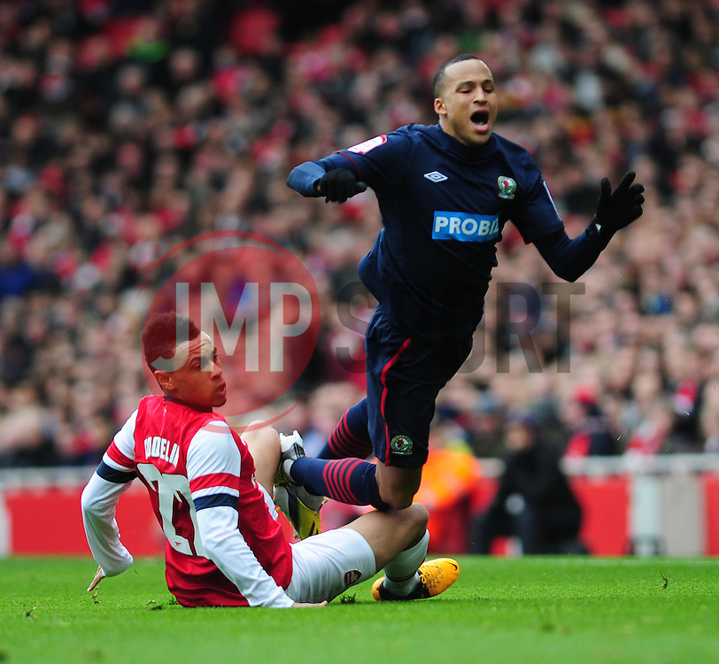 Arsenal's Francis Coquelin trips Blackburn Rovers' Marcus Olsson - Photo mandatory by-line: Dougie Allward/JMP - Tel: Mobile: 07966 386802 16/02/2013 - SPORT - FOOTBALL - Emirates Stadium - London -  Arsenal V Blackburn Rovers - FA Cup - Fifth Round