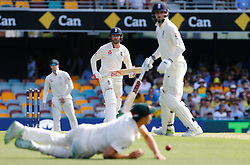 England's Mark Stoneman attempts to drive a ball past Mitchell Starc during day one of the Ashes Test match at The Gabba, Brisbane.