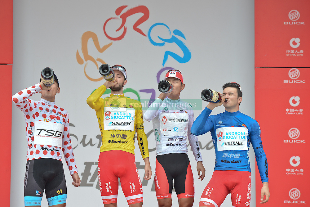 September 16, 2016 - Wuhan, China - (Left-Right) Maral-Erdene Batmunkh - Terengganu Cycling Team (Polka Dot Mountain Jersey), Mattia De Marchi - Androni Giocattoli (Yellow Leader Jersey), Meiyin Wang - Wisdom-Hengxiang Cycling team (White Best China Rider Jersey) and Marco Benfatto - Androni-Giocattoli team (Blue Best Sprinter Jersey) enjoy a Champagne during the final Award Ceremony of the 2016 Tour of China 1..On Friday, 16 September 2016, in Xinzhou, Wuhan , China. (Credit Image: © Artur Widak/NurPhoto via ZUMA Press)