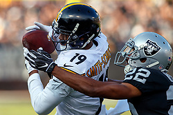 OAKLAND, CA - DECEMBER 09: Wide receiver JuJu Smith-Schuster #19 of the Pittsburgh Steelers catches a pass in front of cornerback Rashaan Melvin #22 of the Oakland Raiders during the second quarter at O.co Coliseum on December 9, 2018 in Oakland, California. (Photo by Jason O. Watson/Getty Images) *** Local Caption *** JuJu Smith-Schuster; Rashaan Melvin