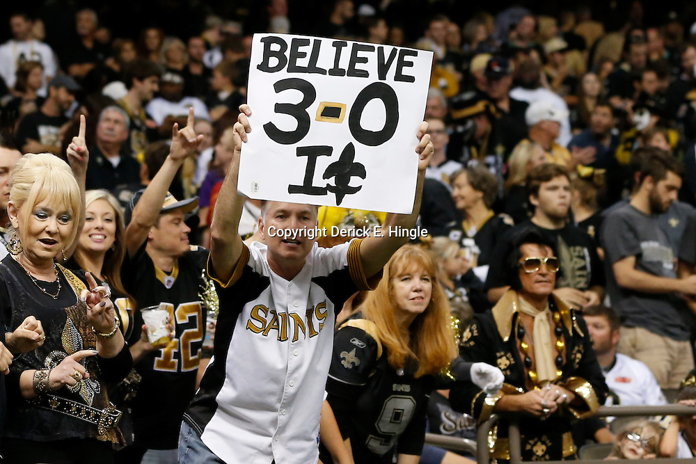 Sep 22, 2013; New Orleans, LA, USA; A New Orleans Saints fan holds up a sign against the Arizona Cardinals during the second half of a game at Mercedes-Benz Superdome. The Saints defeated the Cardinals 31-7. Mandatory Credit: Derick E. Hingle-USA TODAY Sports