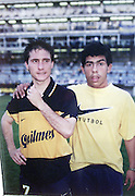 CARLOS TEVEZ in his young years..File pictures form the personal album of CARLOS TEVEZ, in time he was a young player..Here with GUILLERMO BARROS SCHELOTTO  , when TEVEZ was u-16 years and a ball boys at the match..© PikoPress