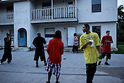 "Fort Myers hip hop artist Alvester Conner, a.k.a. Gutta Slim, records a video in front of his brother's home on Polk Street in Fort Myers with Mami-based rapper, ""Bad Guy.""  Gutta Slim's music speaks of growing up in Fort Myers ? sometimes referred to as ?Li?l Pakistan? for the harsh street life ? and calling out fakers for singing about a life they don?t lead. ?Y?all startin? to piss me off, acting real but inside ... you know you?re soft. Never been in no block, never been in that cell. You?re just a studio gangsta livin? fairytales.? ? Gutta Slim, ?Fairytales?"
