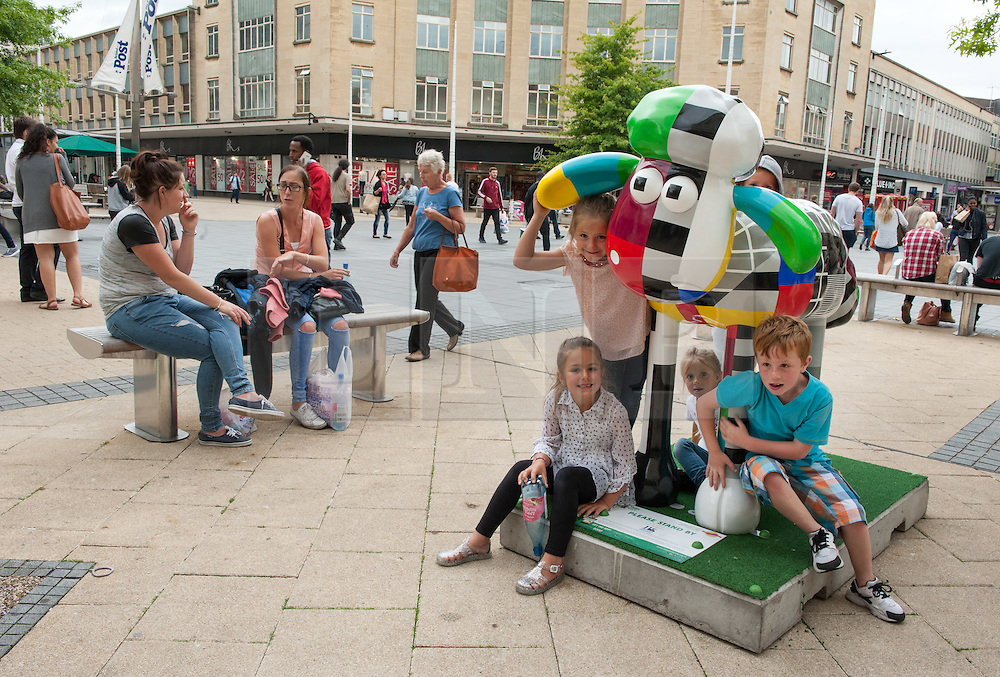 © Licensed to London News Pictures. 06/07/2015. Bristol, UK.  SHAUN THE SHEEP, 'Please Stand By' designed by Timmy Willmott.  The Shaun in the City trail starts today with 70 5ft tall Shaun the Sheep sculptures originally devised by Aardman Animations with these sculptures decorated by various artists.  The Shaun trail happened in London in the spring, and the Bristol Trail lasts till 31 August.  At the end of September all 120 Shaun sculptures will be viewable together in Covent Garden.  All sculptures will then go to auction on 8th October, with proceeds from the Bristol sculptures benefitting The Grand Appeal which funds pioneering medical equipment, facilities, and comforts for patients at Bristol Children's Hospital. Proceeds from the London sculptures will benefit Wallace & Gromit's Children's Charity supporting children's hospitals and hospices throughout the UK. Photo credit : Simon Chapman/LNP