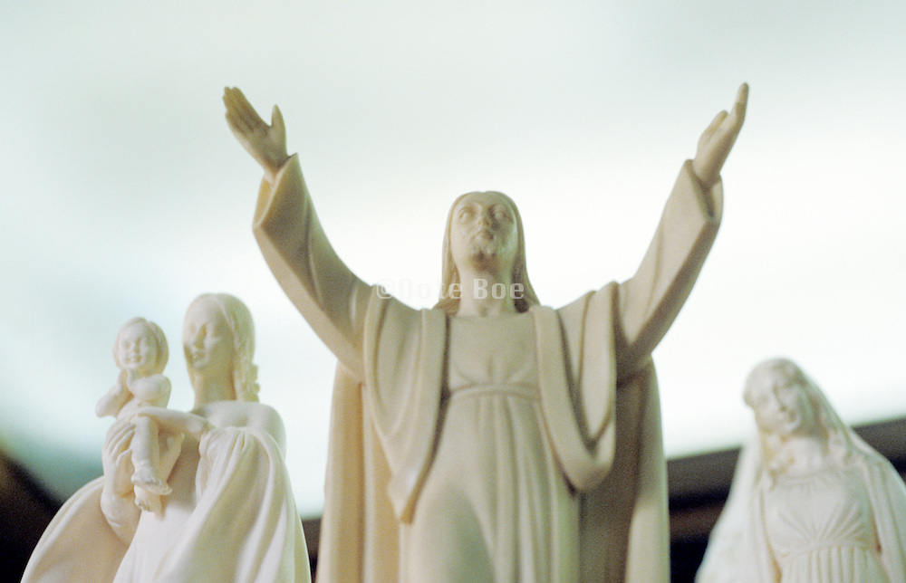 religious figurines of Jesus and Virgin Mary