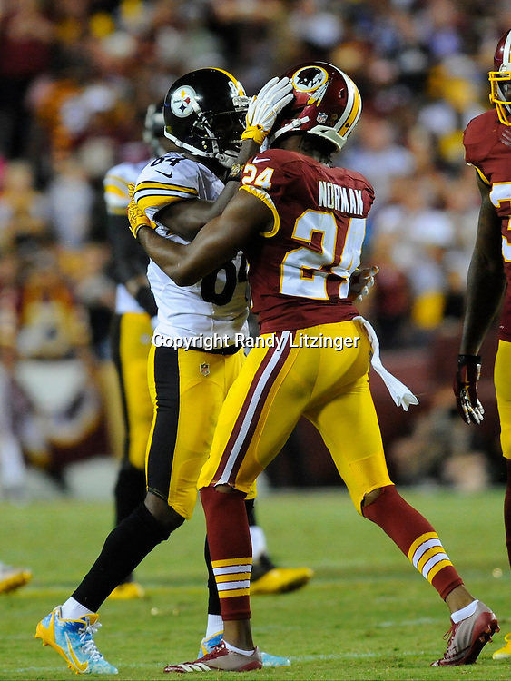 12 September 2016:  Steelers WR Antonio Brown (84) talks with Redskins CB Josh Norman (24) after a play. The Pittsburgh Steelers defeated the Washington Redskins 38-16 on Monday Night Football at FedEx Field in Landover, MD. (Photo by Randy Litzinger/Icon Sportswire)