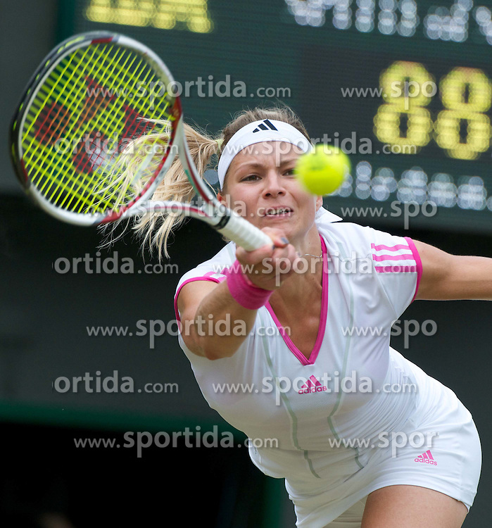 25.06.2011, Wimbledon, London, GBR, Wimbledon Tennis Championships, im Bild Maria Kirilenko (RUS) in action during the Ladies' Singles 3rd Round match on day six of the Wimbledon Lawn Tennis Championships at the All England Lawn Tennis and Croquet Club, EXPA Pictures © 2011, PhotoCredit: EXPA/ Propaganda/ *** ATTENTION *** UK OUT!