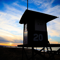 Photo of lifeguard tower 20 during sunrise on Balboa Peninsula in Newport Beach California.  Newport Beach is located in Orange County in Southern California along the Pacific Ocean.
