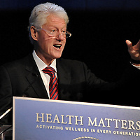 Former President Bill Clinton speaks during the Clinton Foundation's Health Matters Conference at the Renaissance Esmeralda Indian Wells Resort & Spa in Indian Wells, Calif., during the Humana Challenge week, Tuesday, January 17, 2012. (Eric Reed/AP Images for Humana)