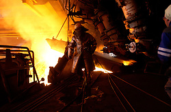 Arcelor employees work in a blast furnace at the Seraing facility near Liege, Belgium. (Photo © Jock Fistick)
