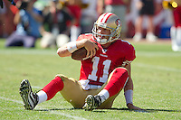 18 September 2011: Quarterback (11) Alex Smith of the San Francisco 49ers sits on the ground after being sacked against the Dallas Cowboys during the first half of the Cowboys 27-24 overtime victory against the 49ers in an NFL football game at Candlestick Park in San Francisco, CA