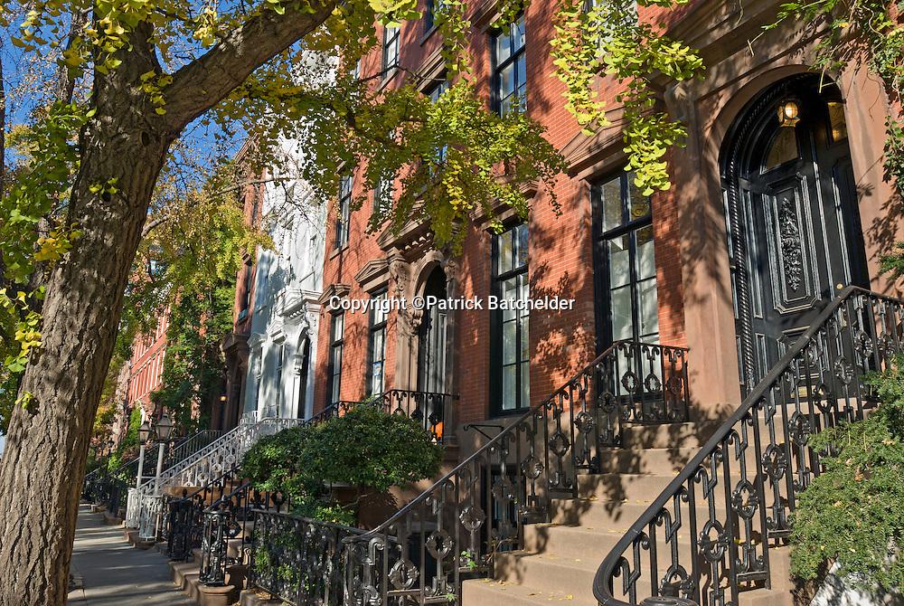 Historic brownstone architecture on Leroy Street, West Village, Greenwich Village, New York City in Autumn.